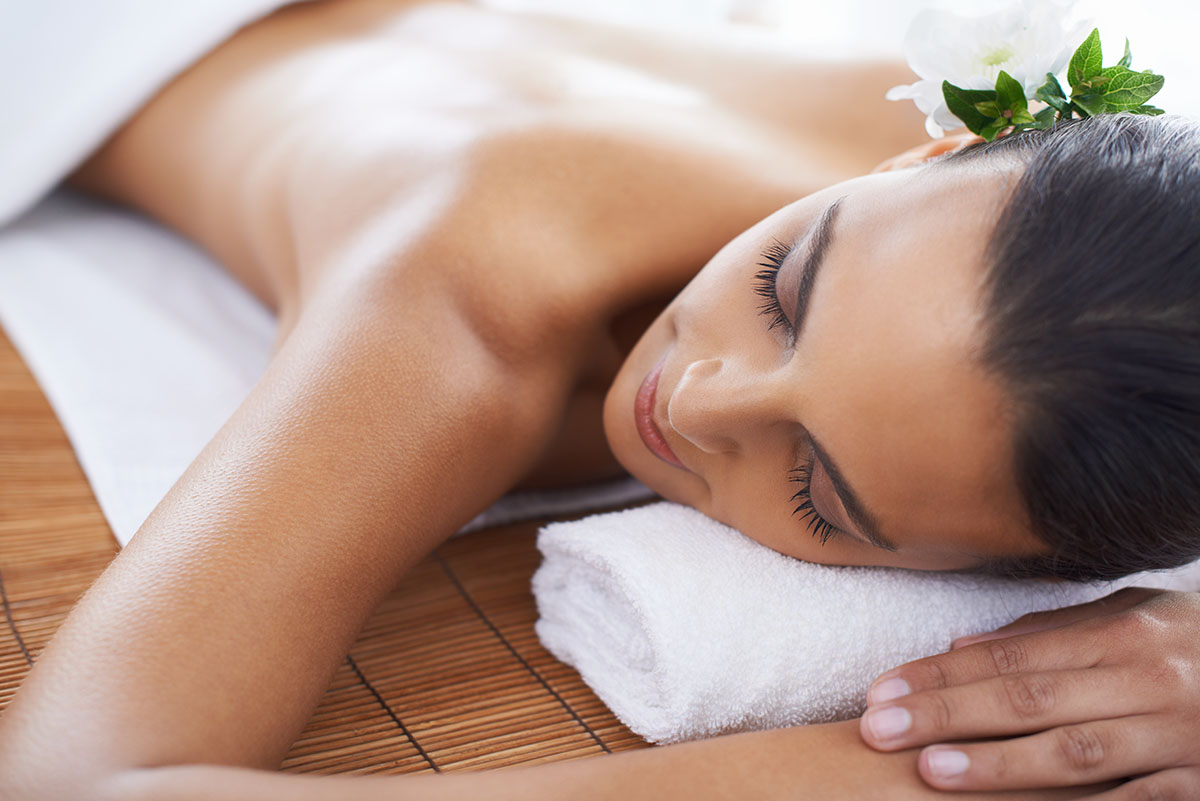 A young woman lying in a health spa